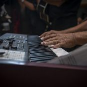 man playing keyboard piano